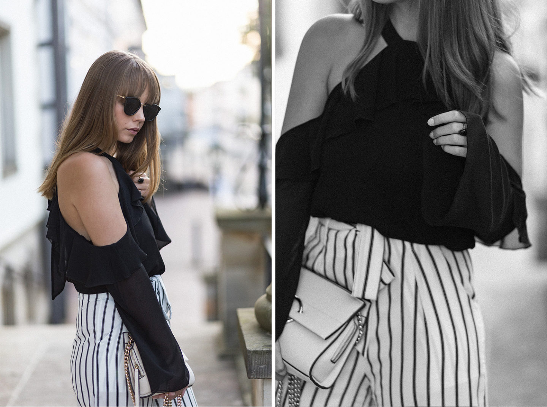 elegantes schwarz weiß outfit schulterfreie bluse mit volant